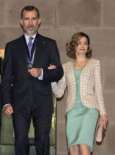 King Felipe VI (L) and Queen Letizia (R) of Spain are seen during a ceremony in which they were given the key to the city by Mexican City Mayor Miguel Mancera (out of frame) in Mexico City on June 29, 2015.