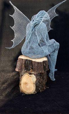 Derek Kinzett. Wire Sculpture. The Wood Cutters Sprite.