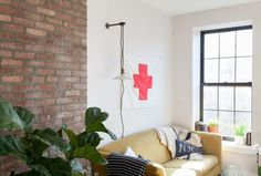 The brick wall adds some texture to the modern style.