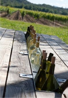 Replace one board of the picnic table with gutter's for a built in drink cooler!