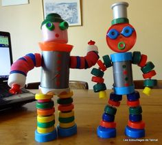 robot made out of recycled materials \ robot made out of recycled materials Plastic Bottle Caps, Bottle Cap Art, Bottle Cap Crafts, Recycle Plastic Bottles, Leaf Crafts, Crafts For Kids, Recycled Robot, Robot Theme, Tin Can Art