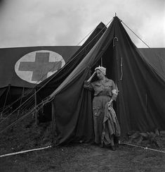 An exhausted nurse at the 44th evacuation hospital, Normandy, France, 1944    This photograph was taken a month after D-day at Bricqueville, Normandy. Forty nurses were attached to this mobile hospital, eight miles south of Omaha Beach. Between 5 July and 4 August they treated some 4,500 patients, of which only 50 died.