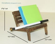 Pallet chair miniature from popsicle sticks. Can be used as cell phone holder or mini office supply desk station.