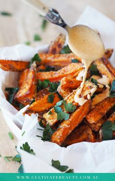 Gluten Free, Dairy Free, Paleo and SIMPLE sweet potato fries with an audible crunch! This tip changed our oven-fries game! Click to get the full recipe and printable recipe card!