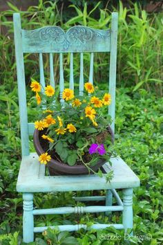 This beautiful old chair was turned into a flower planter - shared at the Knick of Time Tuesday Vintage Style Link Party