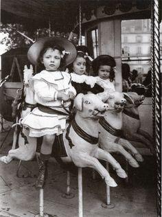 Three little girls on swine - Edwardian carousel ride