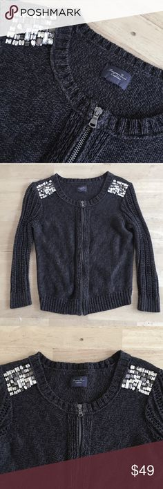 HPAmerican Eagle Crystal Embellished Cardigan HPAmerican Eagle Zip-Up Cardigan with Crystal Embellished Shoulders. 100% Cotton; Heavy Knit. Dark Grey. Crew Neck. NWOT.                                              No Lowball Offers, Please!                             HP - Total Trendsetter by @karamarleu American Eagle Outfitters Sweaters Cardigans
