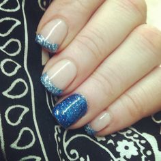 Glitter French in blue on opi gel 2 week manicure. Follow @Nikki71630 on instagram for more pictures