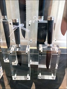 Most often wood blocks are slotted to accept and show off a collection of fine cutlery. Here for display purposes crystal clear acrylic blocks display the knives, and allow blade and handle to be s...