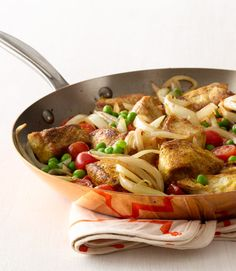 Traditional curry tends to be thick and rich—with calories to match. This 398-calorie version is brighter and lighter, with a thin sauce and curry seasoning rubbed right into the chicken for maximum flavor. Get the recipe  - WomansDay.com