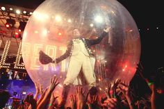 Stephen Colbert stands atop the crowd in a space bubble at StePhest Colbchella '012.