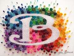 Bright Rainbow Burst Quilled Monogram  This colorful and lively creation is just what your decor needs to help fend off the winter-blues! The