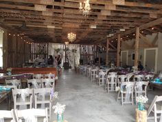 Arbor, tables, some pews and chairs with mason jars and babys breath