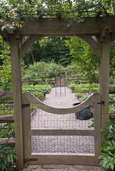 Raised Bed Vegetable & Herbs Garden Fenced Gate, stone pebble walkway, protection from pest animals, fruit trees at rear - my dream garden. Backyard Vegetable Gardens, Potager Garden, Veg Garden, Vegetable Garden Design, Garden Cottage, Garden Beds, Garden Landscaping, Outdoor Gardens, Outdoor Patios