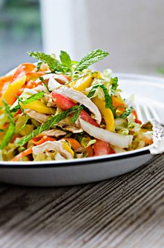 Chinese Chicken Salad with Spicy Ginger Dressing (chicken, napa cabbage, carrots, tomato, mango, scallions, sesame seeds, mint, cilantro, peanuts... just leave out the Sriracha for an easy dressing)