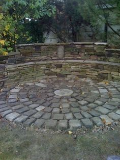 Dry stone walled seating area with reclaimed cobbles