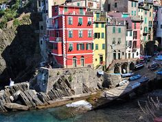There is a wedding on the rocks in Riomaggiore, Cinque Terre, Italy.