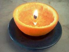ORANGE CANDLE   OMG, this is so clever! Just take an orange/lemon/grapefruit, cut it in half, eat the middle portion, leave the center core-like stem intact. Pour a kitchen oil (vegetable oil, olive oil, etc.) into the orange just below the top of the stem. Light the stem and it will burn for hours and smell absolutely amazing! What a great way to eat healthy while making your house smell great!