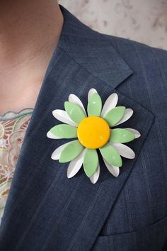 DESCRIPTION: Triple layer pin- two layers of petals and the center. Pin attached at back.    MATERIAL: Painted metal    COLOR: Mint green,