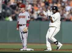 San Francisco Giants' Pablo Sandoval, right, claps as he reaches second base with an RBI double next to Arizona Diamondbacks second baseman Aaron Hill during the first inning of a baseball game Saturday, July 20, 2013, in San Francisco. (AP Photo/Marcio Jose Sanchez)