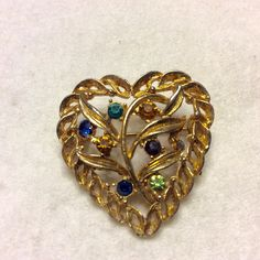 A personal favorite from my Etsy shop https://www.etsy.com/listing/270213461/vintage-family-tree-rhinestones-heart