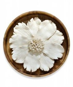 Ceramic flower on wood wall decor