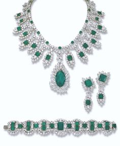AN IMPRESSIVE EMERALD AND DIAMOND PARURE, BY HARRY WINSTON   The fringe necklace designed with a detachable marquise-cut emerald weighing 38.48 carats and diamond pendant suspended from a series of rectangular-shaped emeralds within a vari-cut diamond lozenge-shaped surround to the brilliant-cut diamond double-garland necklace with circular-cut emerald detail, bracelet and detachable ear pendants en suite, necklace 38.0 cm long, bracelet 19.0 cm long, ear pendants 6.0 cm long,