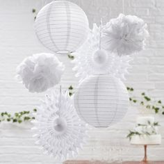The simply stunning hanging decorations include: white tissue paper fan decorations, white paper lanterns and white tissue paper Pom poms. Paper Lanterns Party, Paper Fan Decorations, White Paper Lanterns, White Party Decorations, Hanging Wedding Decorations, Hanging Lanterns, Birthday Decorations, Party Kulissen, Shower Party