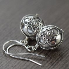 Bali earrings with rounded sterling silver discs.