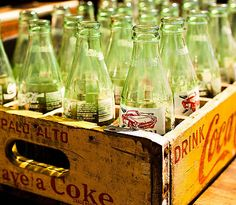 Coke crate with bottles. We put our empties back in the crate and returned to the grocery store for a refund when full. In retrospect, we were recycling before it was fashionable to do so.