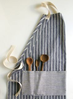 DIY Apron? Im thinking some beautiful retro Goodwill sheets would work beautifully - after a thorough washing of course ;)