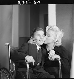 Such a sweet and gorgeous photograph of Marilyn visiting a boy at the St. Jude's Children Hospital in 1953.
