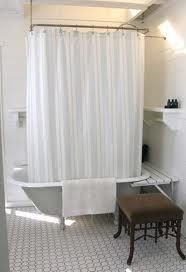 claw foot tub & shower, build a little shelf around the back for storage.
