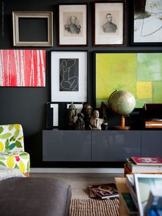 A gallery wall with dark frames looks dramatic on a dark wall.