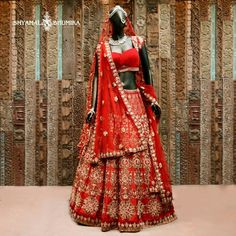 Shyamal and Bhumika indian bridal wear.  Red and gold wedding lehenga