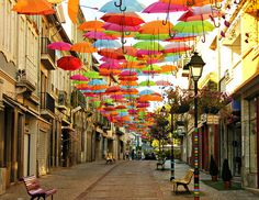 How amazing is this?  Umbrella art installation in Aveiro, Portugal.