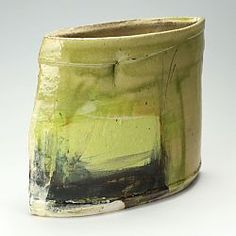 This is a thrown, cut and assembled slipware pot by Barry Stedman using a red earthenware body.