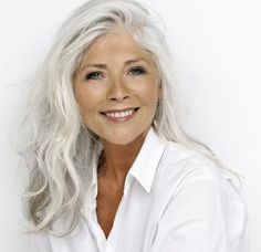 Fashion Over 60: Gun-Britt Zeller (age 63) Danish hairdresser & owner of GB hair care products in white and black apparel
