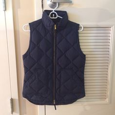 PM EDITOR SHARE Navy J. Crew Vest Popular J. Crew factory excursion vest in navy. Worn once and in perfect condition. Also have the buffalo check one for sale. Has small blue mark on the tag, doesn't effect wear but I just wanted to include. Make an offer or bundle to save! J. Crew Jackets & Coats Vests