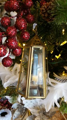 Put flame-less candles in these lanterns to help light up your tree! www.interiorsonmain.com