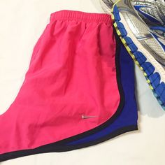Nike Dri-Fit Athletic Shorts • Gently used, no signs of wear • Built-in brief liner • Small pocket inside the back of the shorts to conveniently hold ID or a key  RUNNING SHOES IN COVERSHOT ARE NOT FOR SALE.  Considering reasonable offers! Nike Shorts