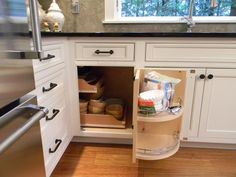 Maximize a blind corner with custom cabinetry. (Cultivate.com)