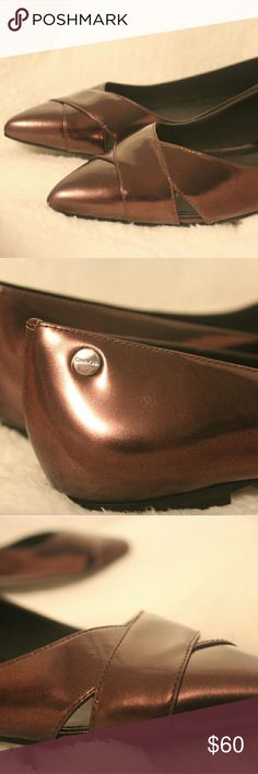 Calvin Klein Gailia Leather Pointed Toe Flat Comfortable leather flats in a beautiful dark cherry metallic color. Crosses at the front with small cutouts to create subtle elegance. Can be worn casually or professionally. Really gorgeous and brand new without tags. Soles are still sparkly clean and leather is in perfect condition. Calvin Klein Shoes Flats & Loafers