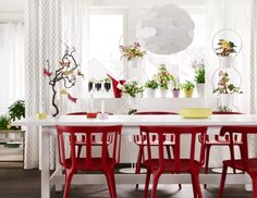 Start with a basic white dining table and use bright chairs and accents to make it your own.