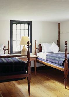 pair of rope beds stand in the spare guest bedroom. The linens are new from Ralph Lauren Home.