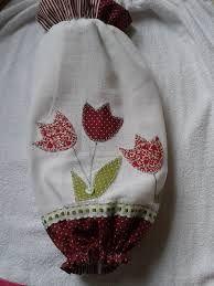 Bolso para guardar bolsas con aplicaciones de tulipanes.