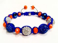 Knicks NY Mets Orange Blue and White Pave by ElizaByrdDesigns, $65.00 can be purchased https://www.etsy.com/listing/117479921/knicks-ny-mets-orange-blue-and-white?ref=sr_gallery_12_search_query=orange+blue+bracelet_page=4_search_type=all_facet=orange+blue+bracelet_view_type=gallery.