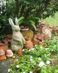 Rabbit statue in cottage garden