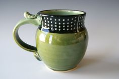Pottery Coffee Mug, Handmade Wheel Thrown Pottery Ceramic Clay in Green Black and White by RiverStone Pottery. $30.00, via Etsy.