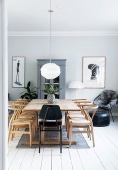 Børge Mogensen table surrounded by Wegner Wishbone Chair